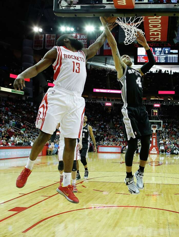 James Harden (13) of the Houston Rockets goes up to block a shoot from Danny Green (4) of the Spurs at Toyota Center on March 24, 2013 in Houston. Photo: Scott Halleran, Getty Images / 2013 Getty Images