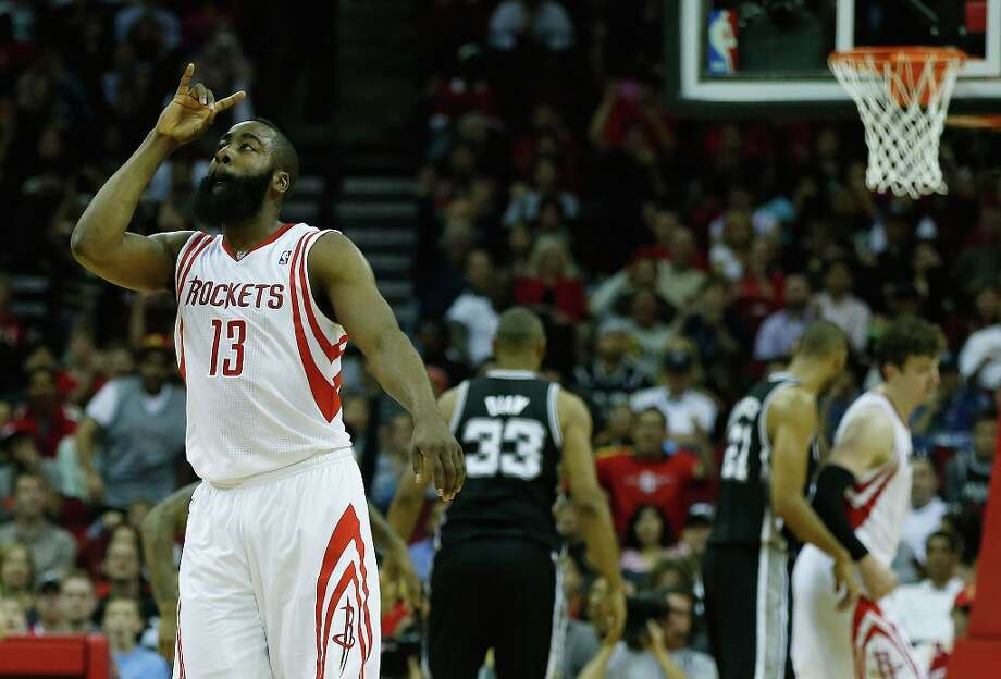 James Harden (13) of the Houston Rockets celebrates a 3-point basket against the Spurs at Toyota Center on March 24, 2013 in Houston. Photo: Scott Halleran, Getty Images / 2013 Getty Images