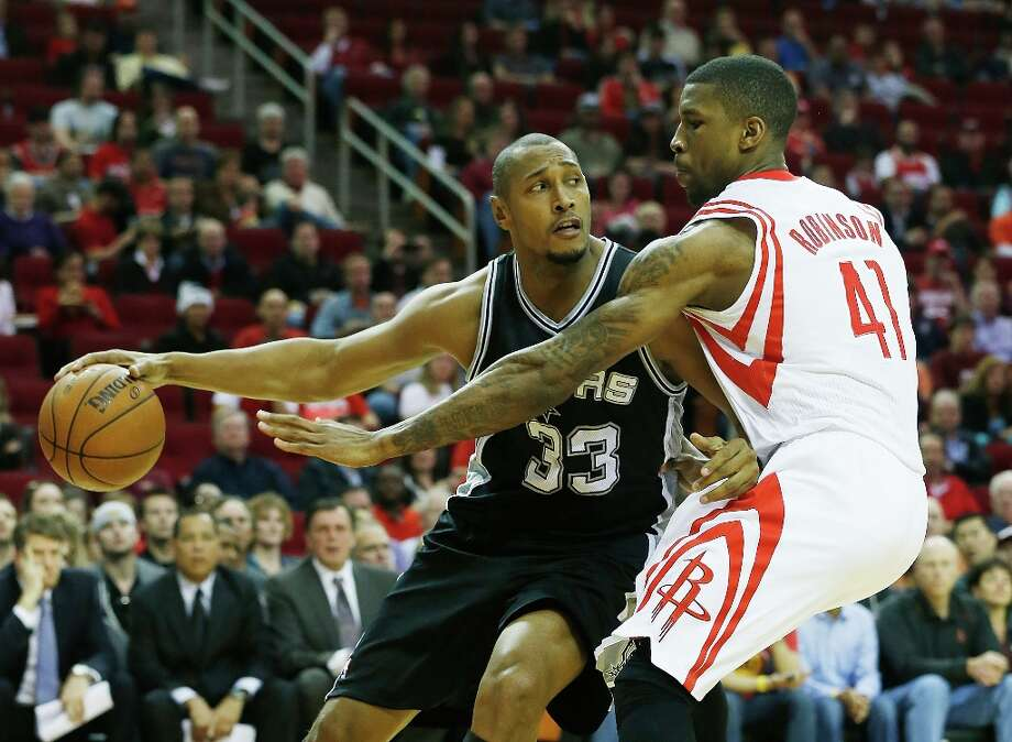 Boris Diaw (33) of the Spurs looks to pass the ball against Thomas Robinson (41) of the Houston Rockets at Toyota Center on March 24, 2013 in Houston. Photo: Scott Halleran, Getty Images / 2013 Getty Images