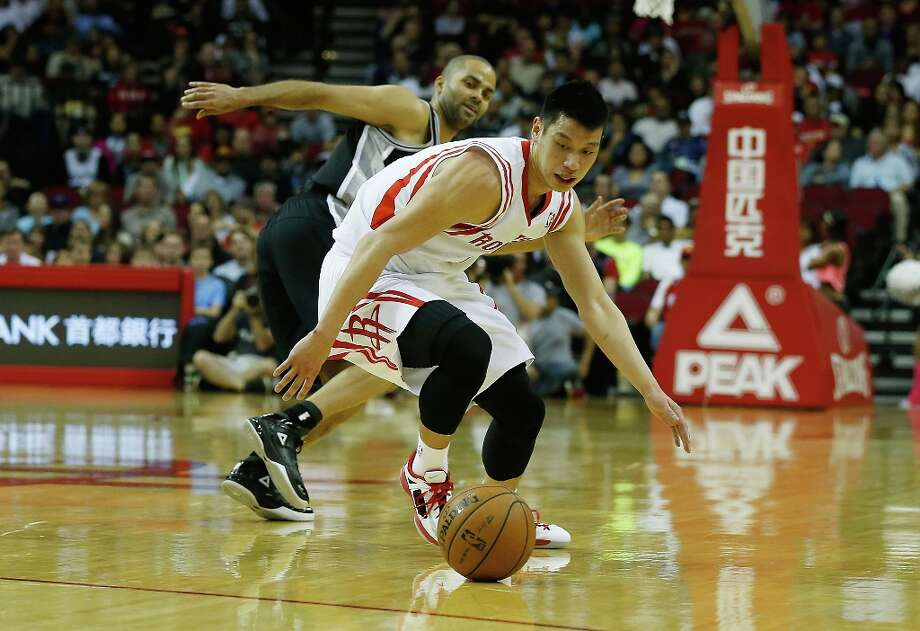 Jeremy Lin (7) of the Houston Rockets reaches for the ball in front of Tony Parker (9) of the Spurs at Toyota Center on March 24, 2013 in Houston. Photo: Scott Halleran, Getty Images / 2013 Getty Images