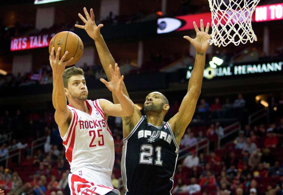 Houston Rockets forward Chandler Parsons (25) shoots against Spurs forward Tim Duncan (21) during the first half Sunday, March, 24, 2013, in Houston. Photo: Patric Schneider, Associated Press / FR170473 AP