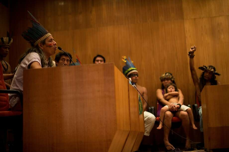 A native man who was evicted from the former Indian Museum, aka Aldea Maracana, testifies at the Federal Court of Justice in Rio de Janeiro, on March 24, 2013. Police on March 22 forcibly ejected some 30 indigenous activists and supporters from Rio's former Indian Museum located next to the Maracana stadium, the venue for the 2014 World Cup final. The planned demolition is at the center of a months-long legal tussle, with authorities saying they will raze the abandoned colonial-style building at the request of football's world governing body as part of an urban renewal program.  Photo: Christophe Simon, AFP/Getty Images