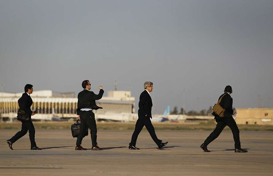 U.S. Secretary of State John Kerry (2nd R) walks across the tarmac of Baghdad International Airport with traveling staff as he prepares to board an aircraft out of the Iraqi capital on March 24, 2013. Kerry pressed Iraq to stop allowing Iranian flights apparently carrying military equipment through its airspace headed to Syria, on a surprise visit to Baghdad.  Photo: Jason Reed, AFP/Getty Images