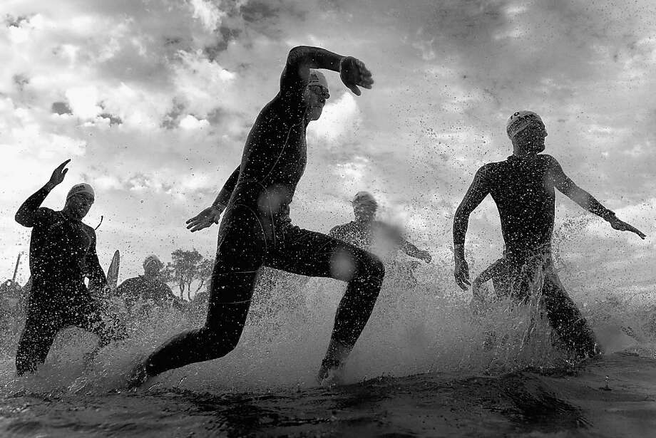 Splash and dash:Tri-athletes sprint into the water to start the Asia-Pacific Ironman Championship in Melbourne, Australia. Photo: Quinn Rooney, Getty Images