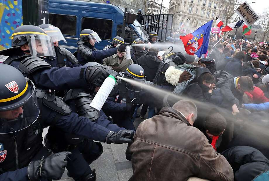 Riot police spray teargas on demonstrators during clashes on the Champs-Elysees avenue in Paris, on March 24, 2013, as thousands of people demonstrated against France's gay marriage law in an attempt to block legislation that will allow homosexual couples to marry and adopt children.  Photo: Thomas Samson, AFP/Getty Images