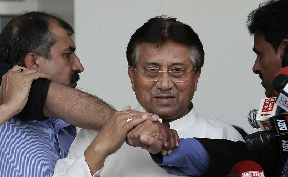 Former Pakistani President Pervez Musharraf, center, surrounded by guards, upon his arrival to Karachi airport, Pakistan, Sunday, March 24, 2013. Former Pakistani President Pervez Musharraf ended more than four years in self-exile Sunday with a flight to his homeland, seeking a possible political comeback in defiance of judicial probes and death threats from Taliban militants.  Photo: Shakil Adil, Associated Press