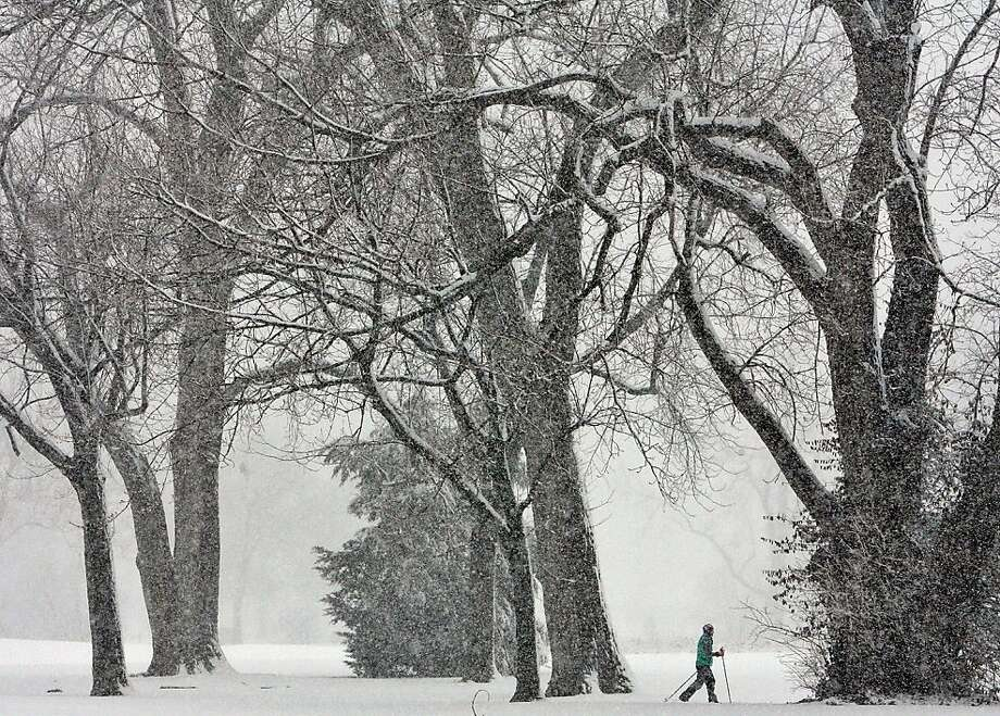 A cross country skier travels through the Forest Park in St. Louis on Sunday afternoon, March 24, 2013. A storm dumped 7 to 9 inches of snow from eastern Kansas into central Missouri before tapering off this morning.  Photo: J.B. Forbes, Associated Press