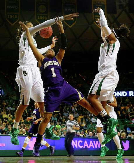 With nowhere to go, Prairie View's Jeanette Jackson (1) has her shot blocked by Baylor's Brittney Griner, left, as Odyssey Sims applies pressure in the first half. Photo: Tom Fox, MBR / Dallas Morning News