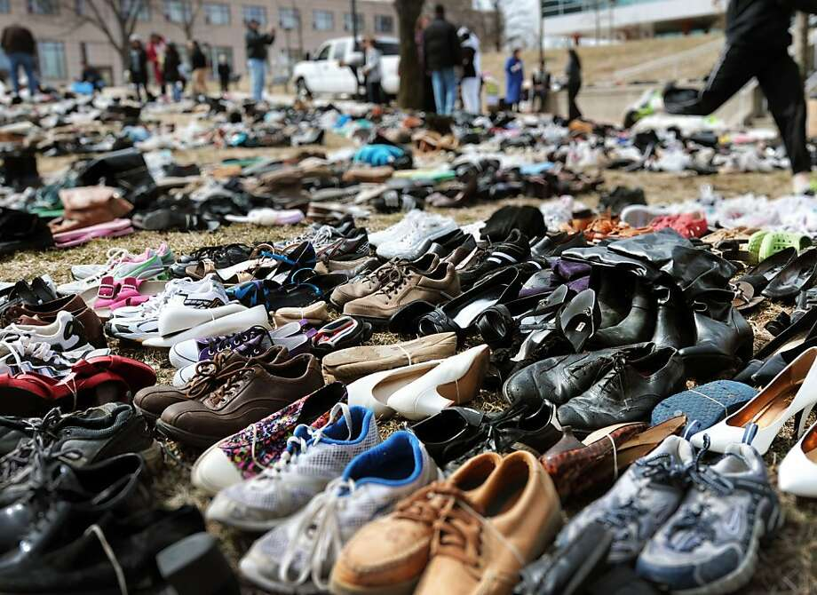 Donated shoes are displayed outside of a student center during the Shoes Against Human Trafficking shoe drive at William Paterson University on Sunday, March 24, 2013, in Wayne, N..J.  Photo: Mitsu Yasukawa, Associated Press