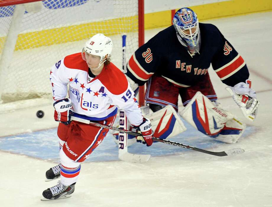 Washington Capitals' Nicklas Backstrom, left, of Sweden, skates away after scoring against New York Rangers goaltender Henrik Lundqvist, of Sweden, do win their NHL hockey game Sunday, March 24, 2013, at Madison Square Garden in New York. The Capitals won, 3-2, in a shootout on Backstrom's goal.  (AP Photo/Bill Kostroun) Photo: Bill Kostroun