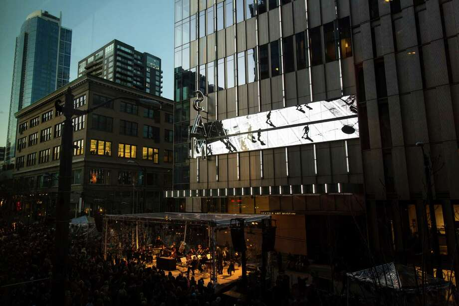 A massive crowd stuck out a chilly yet beautiful evening to enjoy the community celebration and unveiling of MIRROR, a permanent art installation for the façade of the Seattle Art Museum by artist Doug Aitken Sunday, March 24, 2013, in downtown Seattle. MIRROR is an urban earthwork that changes in real time in response to the movement, weather and life of the city around it. Photo: JORDAN STEAD / SEATTLEPI.COM