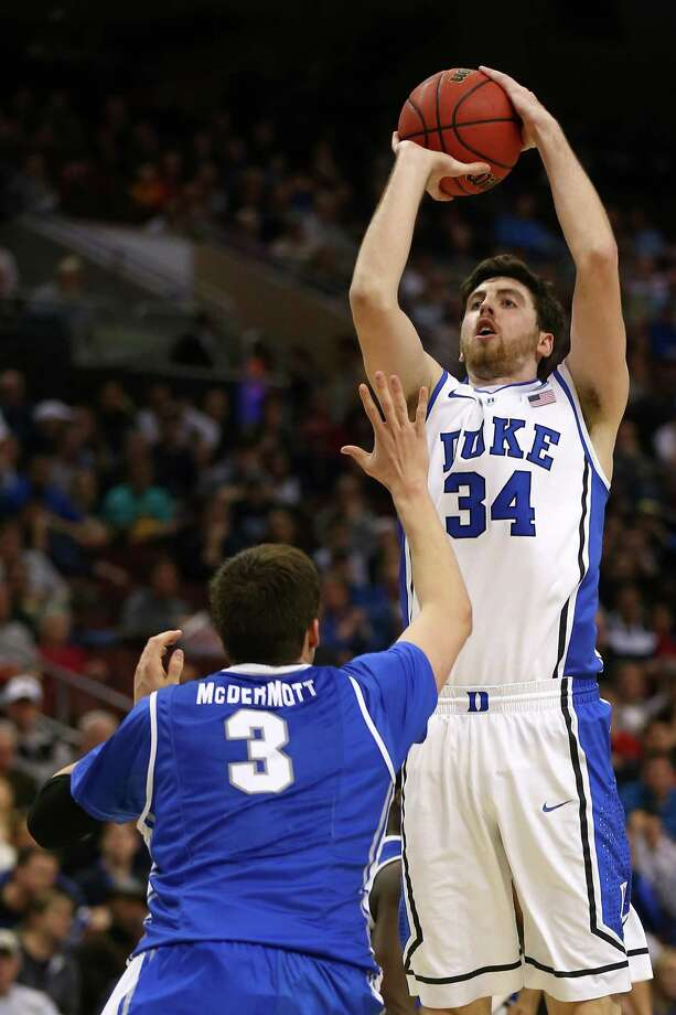 PHILADELPHIA, PA - MARCH 24:  Ryan Kelly #34 of the Duke Blue Devils shoots over Doug McDermott #3 of the Creighton Bluejays in the second half during the third round of the 2013 NCAA Men's Basketball Tournament at Wells Fargo Center on March 24, 2013 in Philadelphia, Pennsylvania. Photo: Elsa, Getty Images / 2013 Getty Images
