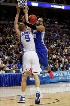 PHILADELPHIA, PA - MARCH 24:  Gregory Echenique #00 of the Creighton Bluejays is fouled by Mason Plumlee #5 of the Duke Blue Devils in the second half during the third round of the 2013 NCAA Men's Basketball Tournament at Wells Fargo Center on March 24, 2013 in Philadelphia, Pennsylvania. Photo: Rob Carr, Getty Images / 2013 Getty Images