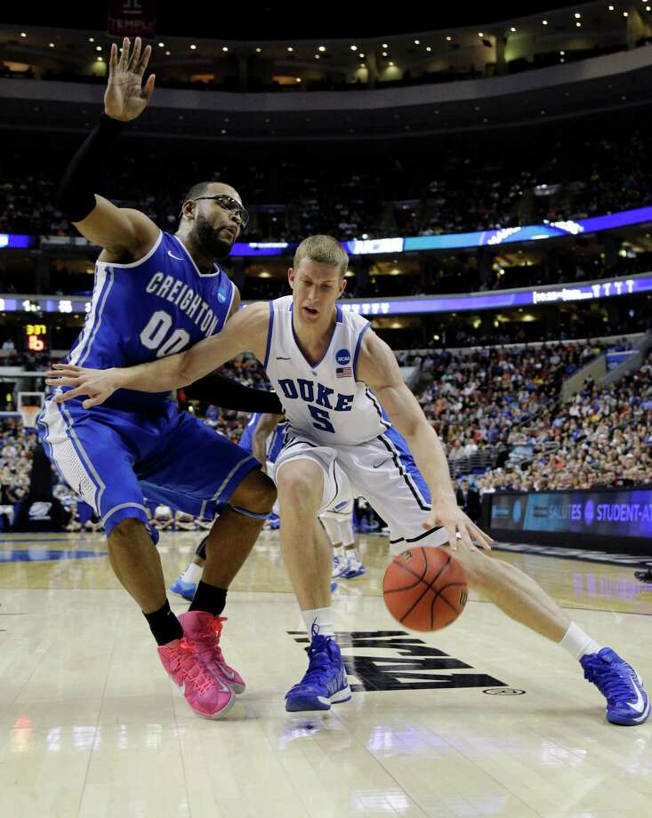Duke's Mason Plumlee, right, drives against Creighton's Gregory Echenique during the first half of a third-round game of the NCAA college basketball tournament, Sunday, March 24, 2013, in Philadelphia. (AP Photo/Matt Slocum) Photo: Matt Slocum, Associated Press / AP