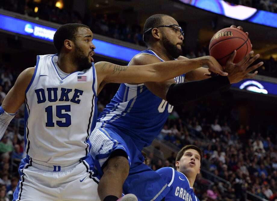 Creighton center Gregory Echenique (0) grabs a rebound from Duke forward Josh Hairston (15) in the first half of the NCAA Tournament in Philadelphia, Pennsylvania, Sunday, March 24, 2013. (Chuck Liddy/Raleigh News & Observer/MCT) Photo: Chuck Liddy, McClatchy-Tribune News Service / Raleigh News & Observer