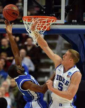 Duke forward Mason Plumlee (5) contests a first-half shot by Creighton guard Jahenns Manigat (12) during the NCAA Tournament in Philadelphia, Pennsylvania, Sunday, March 24, 2013. (Chuck Liddy/Raleigh News & Observer/MCT) Photo: Chuck Liddy, McClatchy-Tribune News Service / Raleigh News & Observer