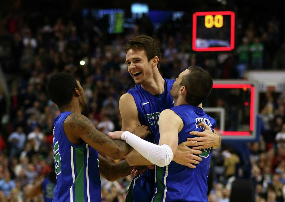 As the clock wound down, Dajuan Graf, Eddie Murray and Brett Comer got the party started for Florida Gulf Coast, the first No. 15 seed to make the Sweet 16. Photo: Elsa, Staff / 2013 Getty Images