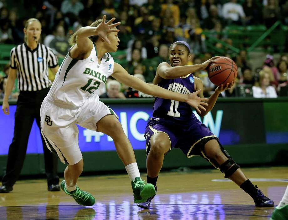 Baylor guard Alexis Prince (12) defends against a drive to the basket by Prairie View A&M guard Gabrielle Scott (11) in the first half of a first-round game in the women's NCAA college basketball tournament Sunday March 24, 2013, in Waco, Texas. (AP Photo/Tony Gutierrez) Photo: Tony Gutierrez, Associated Press / AP
