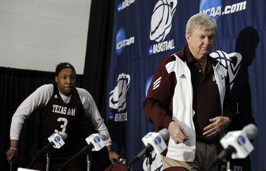 A&M coach Gary Blair, flanked by star center Kelsey Bone, led the Aggies to the SEC tournament title in their first year in the conference. Blair also led A&M to the 2011 national title. Photo: Pat Sullivan / Associated Press