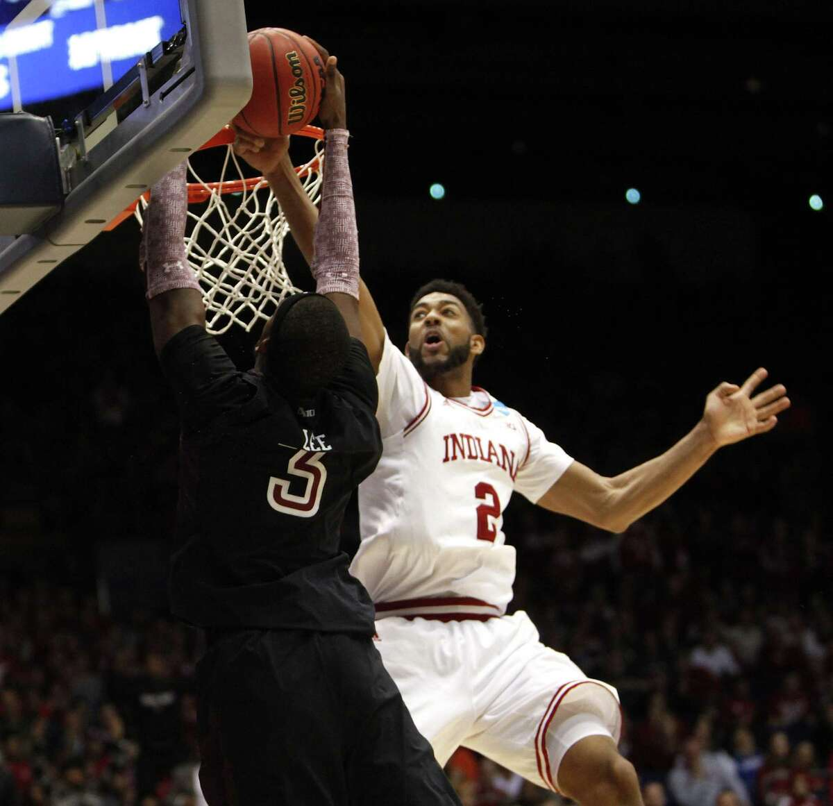 Indiana's Christian Watford blocks a shot by Temple's Anthony Lee during the second half. The Hoosiers closed with a 10-0 run en route to the 58-52 victory.