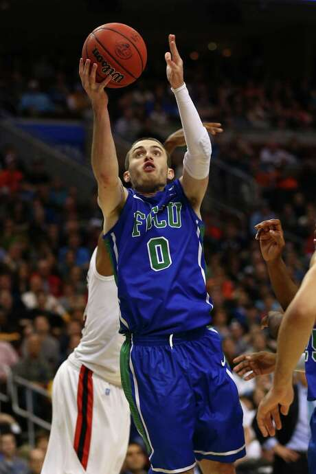 Brett Comer, going up for a shot, helped Florida Gulf Coast race past favored San Diego State, 81-71 on Sunday. Photo: Elsa / Getty Images