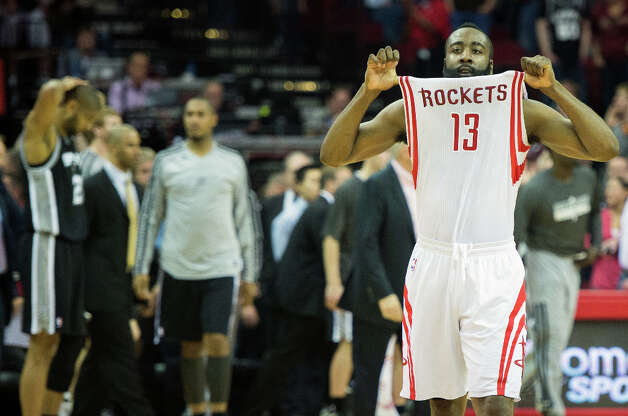 March 24: Rockets 96, Spurs 95Rockets shooting guard James Harden celebrates as Spurs power forward Tim Duncan hangs his head.  Harden hits a jumper with 4.5 seconds left in the game for the game-winner in a 96-96 victory over the Spurs. Photo: Smiley N. Pool, Houston Chronicle / © 2013  Houston Chronicle