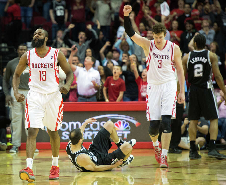 Rockets shooting guard James Harden and center Omer Asik celebrate after defeating the Spurs. Photo: Smiley N. Pool, Houston Chronicle / © 2013  Houston Chronicle