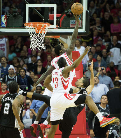 Rockets point guard Patrick Beverley (12) swats a shot by Spurs shooting guard Danny Green (4) as shooting guard James Harden (13) defends. Photo: Smiley N. Pool, Houston Chronicle / © 2013  Houston Chronicle