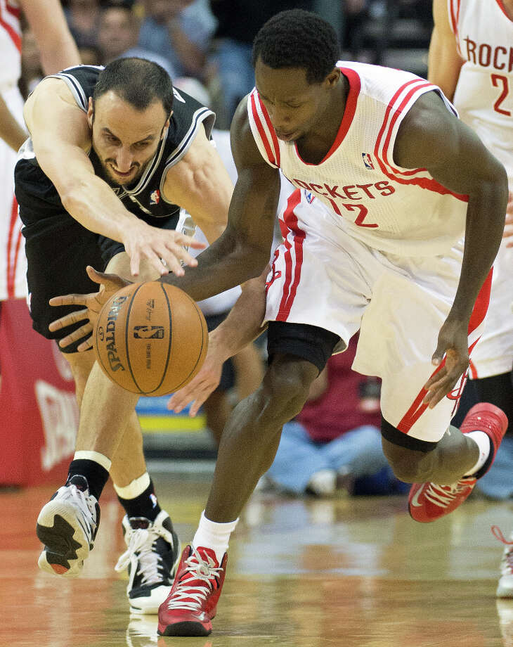 Rockets point guard Patrick Beverley steals the ball from Spurs shooting guard Manu Ginobili. Photo: Smiley N. Pool, Houston Chronicle / © 2013  Houston Chronicle