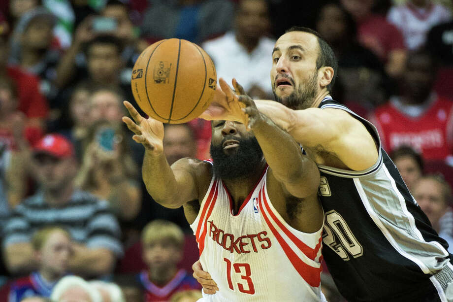 Spurs shooting guard Manu Ginobili knocks a pass away from Rockets shooting guard James Harden. Photo: Smiley N. Pool, Houston Chronicle / © 2013  Houston Chronicle