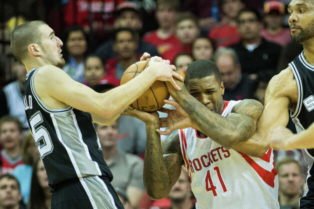 Spurs point guard Nando de Colo steals the ball from Rockets power forward Thomas Robinson. Photo: Smiley N. Pool, Houston Chronicle / © 2013  Houston Chronicle