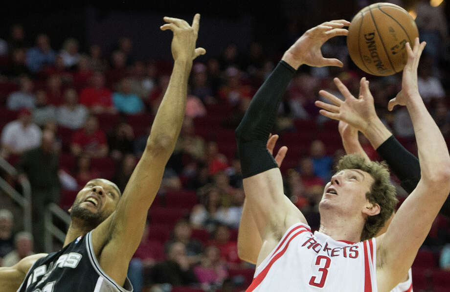 Rockets center Omer Asik grabs a rebound away from Spurs power forward Tim Duncan. Photo: Smiley N. Pool, Houston Chronicle / © 2013  Houston Chronicle