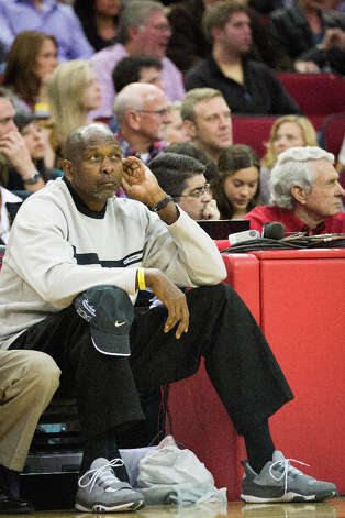 Moses Malone watches from court side as the Rockets face the Spurs. Photo: Smiley N. Pool, Houston Chronicle / © 2013  Houston Chronicle