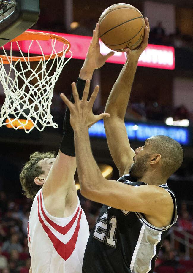 Rockets center Omer Asik blocks a shot by San Antonio Spurs power forward Tim Duncan. Photo: Smiley N. Pool, Houston Chronicle / © 2013  Houston Chronicle
