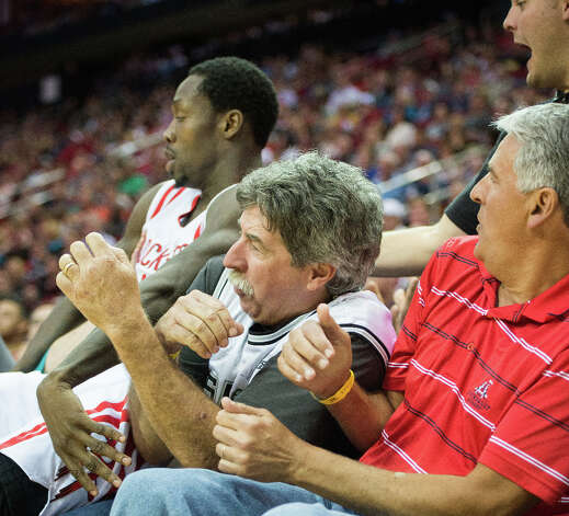 Rockets point guard Patrick Beverley falls into the front row of the crowd chasing a loose ball. Photo: Smiley N. Pool, Houston Chronicle / © 2013  Houston Chronicle