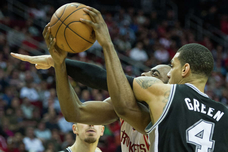 Rockets shooting guard James Harden is fouled by Spurs shooting guard Danny Green. Photo: Smiley N. Pool, Houston Chronicle / © 2013  Houston Chronicle