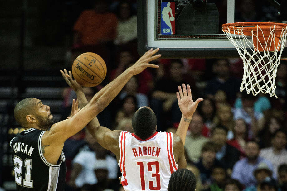 Spurs power forward Tim Duncan knocks the ball away from Rockets shooting guard James Harden. Photo: Smiley N. Pool, Houston Chronicle / © 2013  Houston Chronicle