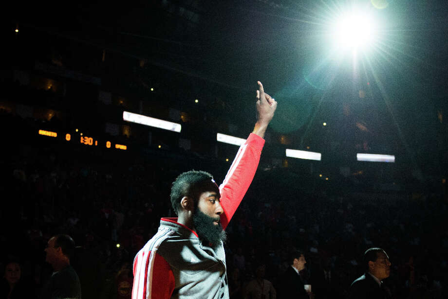 Rockets shooting guard James Harden waves to the crowd as he is introduced before facing the San Antonio Spurs. Photo: Smiley N. Pool, Houston Chronicle / © 2013  Houston Chronicle