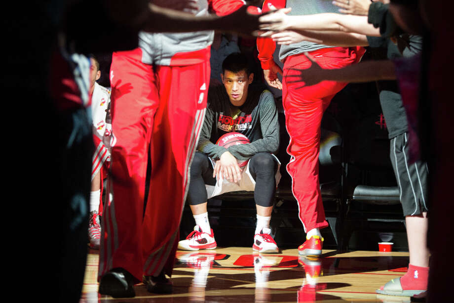 Rockets point guard Jeremy Lin waits to take the floor during pre game introductions. Photo: Smiley N. Pool, Houston Chronicle / © 2013  Houston Chronicle