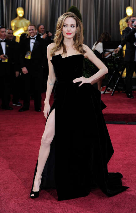 Actress Angelina Jolie arrives at the 84th Annual Academy Awards at the Hollywood & Highland Center February 26, 2012 in Hollywood, California. It can be safely said that this was the actress at her most irritating. What is it with the leg?  What is she doing? (suggested by reystjohn) Photo: Ethan Miller, Getty Images / 2012 Getty Images