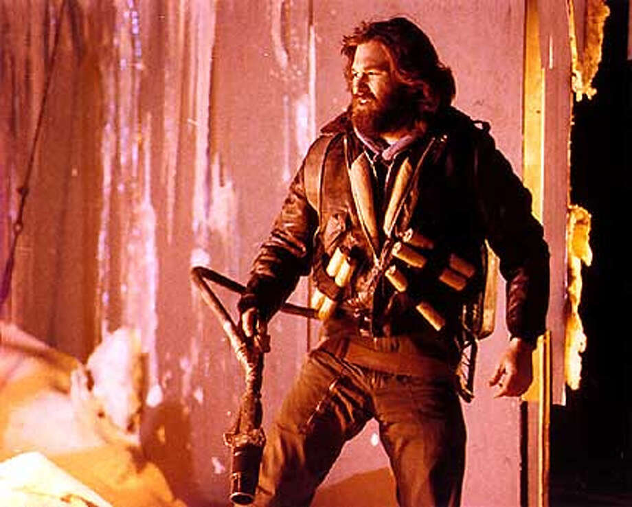 """The Thing"" (1982)  One of John Carpenter's best films. Also one of Kurt Russell's best. Truly freaky stuff  with actually scary moments. The 2011 version deserves props for being a  clever  prequel."