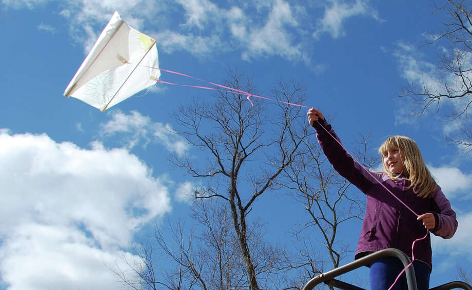 Abigail Morse, 9, gives her kite a head start Saturday from atop a slide at Earthplace, where all things that soar were celebrated on Kite Day.  WESTPORT NEWS, CT 3/23/13 Photo: Jarret Liotta / Westport News contributed