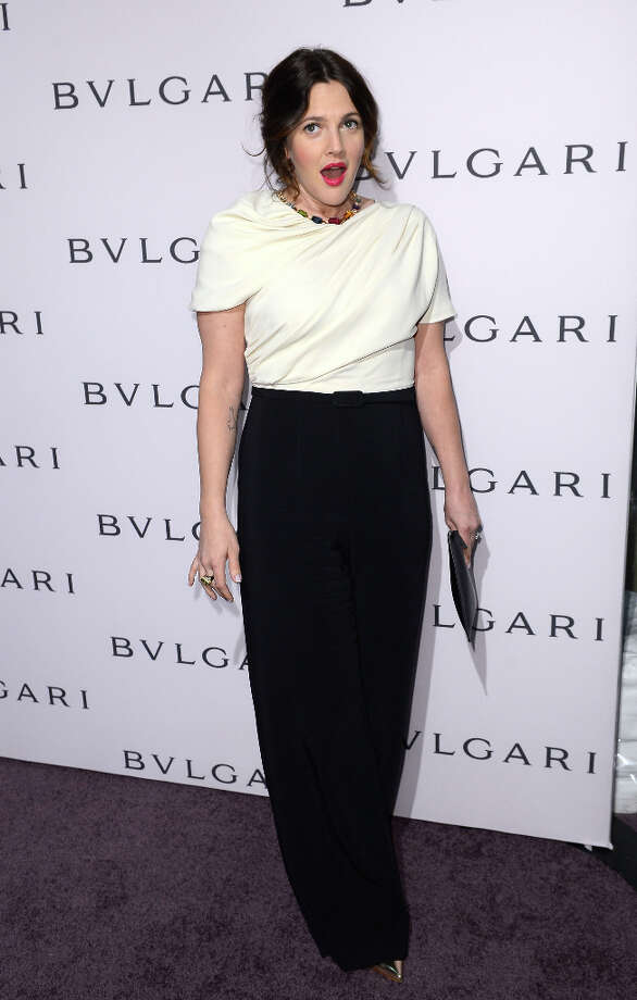 Actress Drew Barrymore, wearing BVLGARI, arrives at the BVLGARI celebration of Elizabeth Taylor's collection of BVLGARI jewelry at BVLGARI Beverly Hills on February 19, 2013 in Los Angeles, California. (suggested by drimblewedge) Photo: Mark Davis, Getty Images / 2013 Getty Images