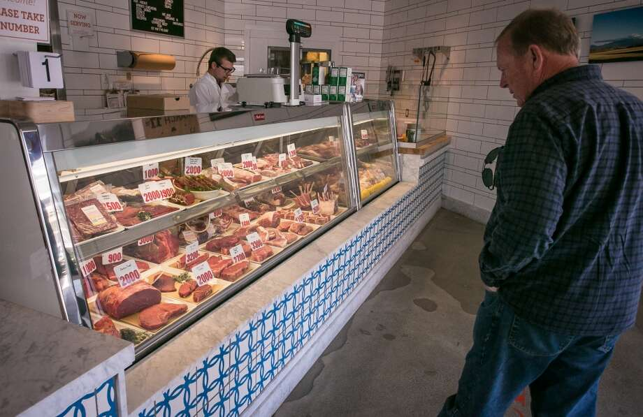 A man surveys the meat case at Belcampo.
