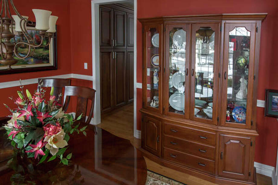 Paul Krass made the china cabinet that is in the dining room in the home of  he and his wife J'Lene's home, on Tuesday Feb. 12, 2013 in Saratoga Springs, NY. Photo: Philip Kamrass /  2013 Philip Kamrass