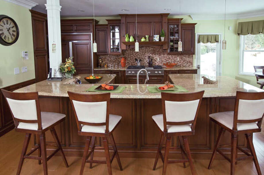 View of the kitchen in the home of  Paul and J'Lene Krass, on Tuesday Feb. 12, 2013 in Saratoga Springs, NY. Photo: Philip Kamrass /  2013 Philip Kamrass