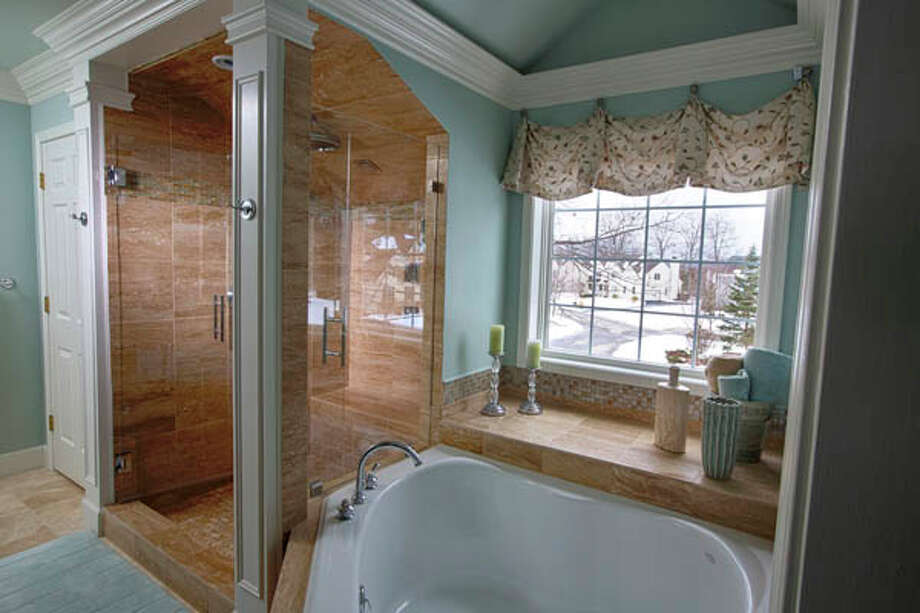 View of the master bathroom in the home of  Paul and  J'Lene Krass, on Tuesday Feb. 12, 2013 in Saratoga Springs, NY. Photo: Philip Kamrass /  2013 Philip Kamrass
