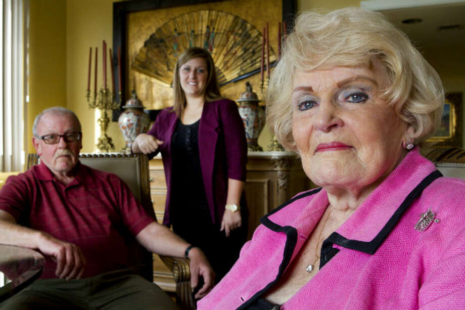 Hellen Reasoner Hutchison (right) sits with her son, Rick L. Reasoner and granddaughter, Rachel Reasoner, at her home in Houston. Hutchison is an early-day female landman, leasing mineral rights for oil companies. Even though she is semi-retired, Hutchison still runs her own company and is legendary in the field for breaking barriers for women.