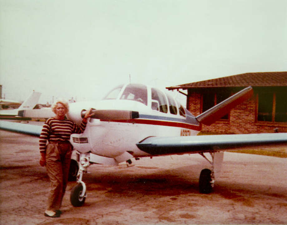 Hellen Reasoner Hutchison standing in front of her airplane in this undated family photo.
