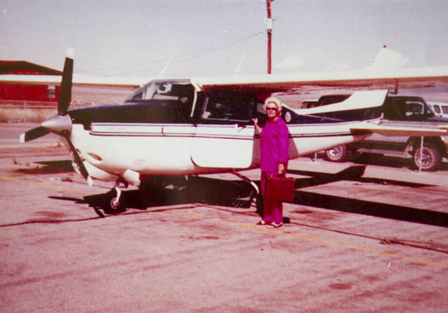 Hellen Reasoner Hutchison is shown posing in front of her airplane in this undated family photo.